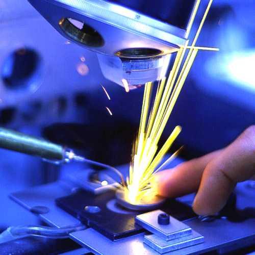 Laser drilling slits into a disk